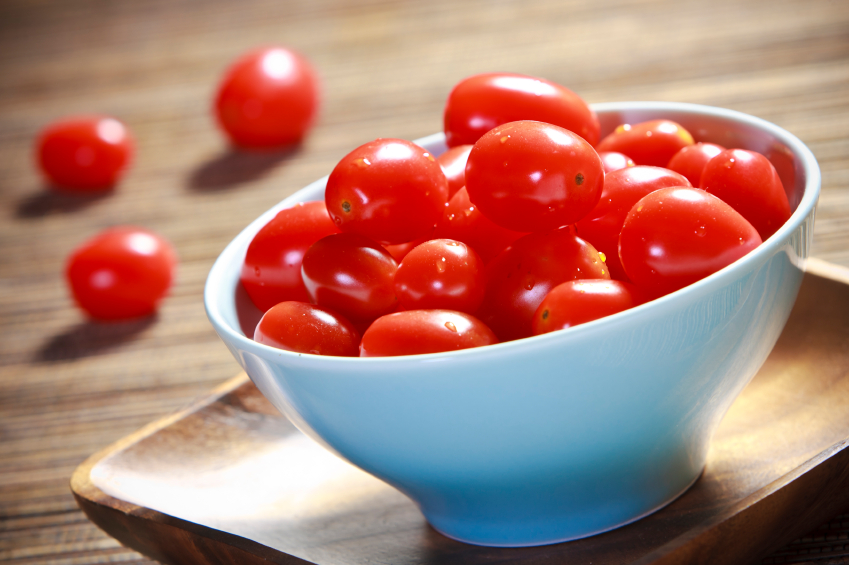 Cherry tomatoes in a blue bowl