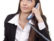 businesswoman having  boring call in office